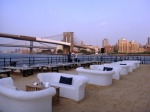 Beekman Beer Garden Beach Club. Sand, fire pits, beers on tap and skyline views. Nothing sounds more like summer in New York. Oh, and it's open at noon every day. Accessible by the A, C, J, M, Z, 2, 3, 4, 5 at Fulton Street. The Beekman Beer Garden is located at Beekman Street and South Street on the north side of Pier 17.